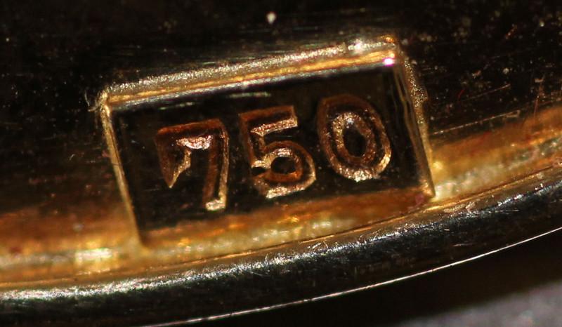 Клеймо 750 пробы